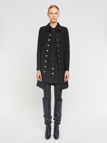 Mini-jupe boutonnée en tricotine stretch - Noir